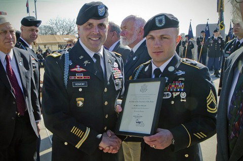 U.S. Army Sgt. 1st Class Billy R. Weiland, a Soldier with 1st Battalion, 506th Infantry Regiment, 4th Brigade Combat Team, 101st Airborne Division (Air Assault), was presented a certificate by Col. Val C. Keavney Jr., commander of the 4th BCT, 101st Abn. Div., formally inducting him as a Distinguished Member of the 506th Infantry Regiment, during a ceremony March 13, 2014. (U.S. Army photo by Sgt. Justin A. Moeller, 4th Brigade Combat Team Public Affairs)