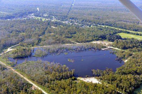Aerial photo of a 25-acre sinkhole that formed unexpectedly near Bayou Corne, La., in Aug. 2012. New analyses of NASA airborne radar data collected in 2012 reveal the radar detected indications of the sinkhole before it collapsed and forced evacuations. Such data may someday help foresee sinkholes. (On Wings of Care)