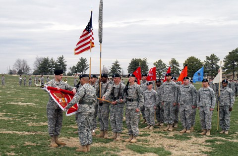 Lt. Col. Zachary Miller (left), commander of the former 3rd Special Troops Battalion and commander of the newly reflagged 21st Brigade Engineer Battalion, and Command Sgt. Maj. Martin Humphreys, the senior enlisted advisor for 21st BEB, uncase the colors of the newly stood up 21st BEB during a ceremony at the division parade field on Fort Campbell, March 27, 2014. (Photo by Sgt. Brian Smith-Dutton, 3rd BCT Public Affairs)