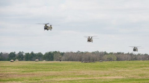 CH-47 Chinook helicopters with B Company, 6th Battalion, 101st Combat Aviation Brigade, 101st Airborne Division (Air Assault,) fly into a pick-up zone during a rehearsal for Exercise Golden Eagle at Fort Campbell, Ky., April 4, 2014. Exercise Golden Eagle is a brigade-level air assault exercise where 101st CAB and 3rd Brigade Combat Team, 101st Airborne Division (AASLT,) work together to refine air assault tactics. (Sgt. Duncan Brennan/U.S. Army)