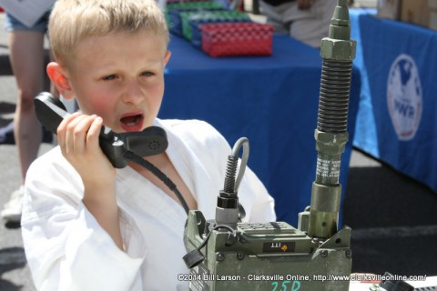 A young boy tries out the 5th Special Forces Group Satcom Gear at the 2014 Rivers and Spires Festival