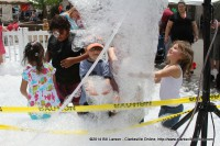 Kids play in the Bubble Machine at the 2014 Rivers and Spires Festival