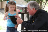 The young girl helping Magician Wallace Redd with his magic trick