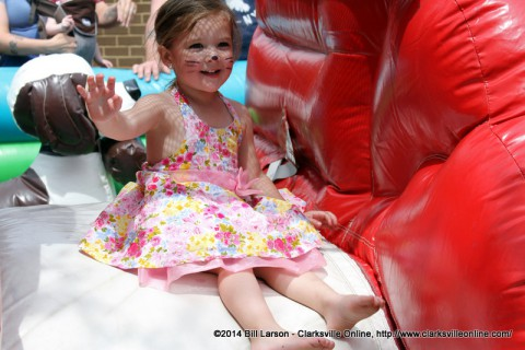 A young girl enjoys one of the Inflatables at the 2014 Rivers and Spires Festival