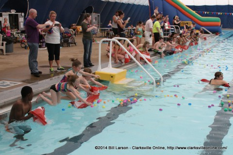 Children lining the edge of the pool as the signal is given to go into the pool at the City of Clarksville's Wettest Egg Hunt on Saturday
