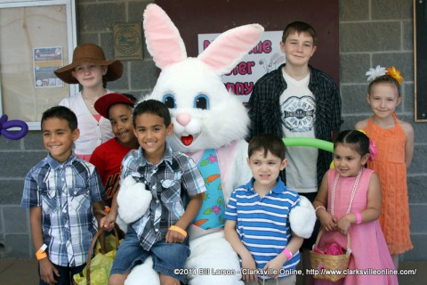 A family poses for a photo with the Easter Bunny at the City of Clarksville's 2014 Spring Eggstravaganza