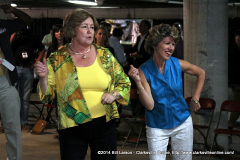 Montgomery County Mayor Carolyn Bowers and Clarksville Mayor Kim McMillan trying out Dance Dance Revolution at the CDE Lightband Gig City Gaming Area.