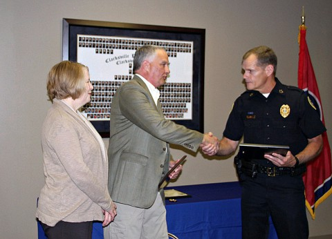 Chief Al Ainsley presents with Sgt. David Jones with his retirement certificate