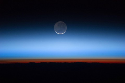 Astronauts aboard the International Space Station captured this photograph of Earth's atmospheric layers on July 31, 2011, revealing the troposphere (orange-red) to the stratosphere and above. Earth-observing instruments in space allow scientists to better understand the chemistry and dynamics occurring within and between these layers. (NASA/JSC Gateway to Astronaut Photography of Earth)