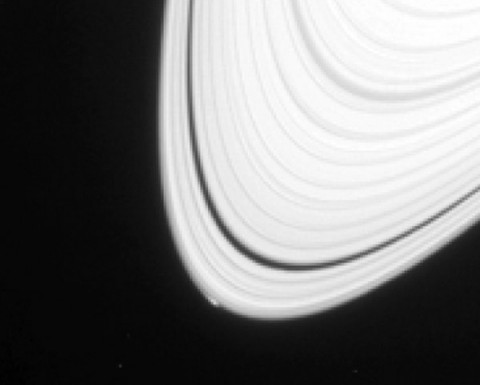 The disturbance visible at the outer edge of Saturn's A ring in this image from NASA's Cassini spacecraft could be caused by an object replaying the birth process of icy moons. (NASA)