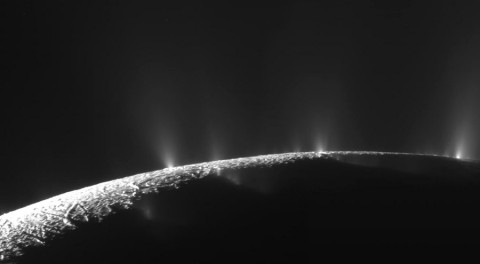 Watery jets erupting from locations near the south pole of Enceladus.