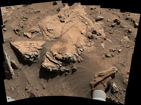 "NASA's Curiosity Mars rover has driven within robotic-arm's reach of the sandstone slab at the center of this April 23 view from the rover's Mast Camera. The rover team plans to have Curiosity examine a target patch on the rock, called ""Windjana,"" to aid a decision about whether to drill there. (NASA/JPL-Caltech/MSSS)"