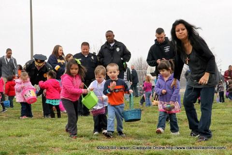 Kids scoop up Easter Eggs during the City of Clarksville's 2013 Spring Eggstravanganza Easter Egg Hunt