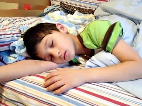 Photo of a young boy, sleeping. (Credit: Bijal Trivedi)