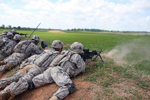Soldiers with 1st Platoon, Company D, 1st Battalion, 327th Infantry Regiment, 1st Brigade Combat Team, 101st Airborne Division (Air Assault), provide suppressive fire during a walk and shoot exercise May 8, 2014, near Observation Post 13 at Fort Campbell, Ky. (Sgt. Jon Heinrich)