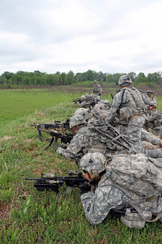 Soldiers with 3rd Platoon, Company B, 2nd Battalion, 327th Infantry Regiment, 1st Brigade Combat Team, 101st Airborne Division (Air Assault), form a firing line on a berm to provide suppressive fire during a walk and shoot exercise May 9, 2014, near Observation Post 13 at Fort Campbell, Ky. (Sgt. Jon Heinrich)