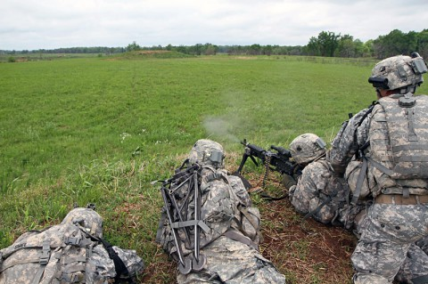 Soldiers with 3rd Platoon, Company B, 2nd Battalion, 327th Infantry Regiment, 1st Brigade Combat Team, 101st Airborne Division (Air Assault), provide suppressive fire during a walk and shoot exercise May 9, 2014, near Observation Post 13 at Fort Campbell, Ky. (Sgt. Jon Heinrich)