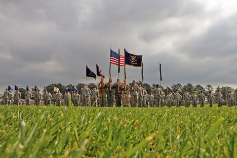 The color guard of the 4th Brigade Combat Team, 101st Airborne Division (Air Assault), dressed in uniforms from past to present, stand at attention during the inactivation and relinquishment of command ceremony at the division parade field at Fort Campbell, KY, April 25th, 2014. (U.S. Army photo by Sgt. Justin A. Moeller, 4th BCT Public Affairs)