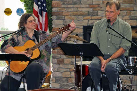 Nashville musicians Carol Ponder and her husband Richard Kiefer perform a portion of her father's memoirs as readers-theater-with-music for Soldiers and their Families at the Fort Campbell Soldier and Family Assistance Center May 15, 2014 during National Mental Health Month. (U.S. Army photo by Sgt. Eric Lieber)