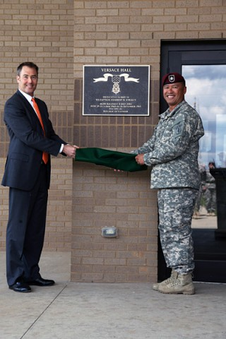 "Lieutenant Col. Fred Dela Cruz, commander of the Group Support Battalion, 5th Special Forces Group (Airborne), is joined by Mr. Roque Versace, nephew of Capt. Humberto ""Rocky"" Versace, following the dedication of the GSB headquarters building in honor of Capt. Versace May 16, 2014, at Fort Campbell, Ky.  (Pvt. 1st Class Robert Venegas)"