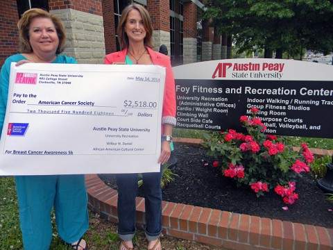 Jerri Rule (left) with the American Cancer Society received a $2,518.00 donation from Lauren-Michael Wilkinson (right).