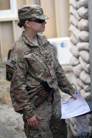 U.S. Army Capt. Samantha Reid, preventive medicine officer with Company C, 526th Brigade Support Battalion, 2nd Brigade Combat Team, 101st Airborne Division (Air Assault), prepares to set a bug trap for sample collection at Forward Operating Base Gamberi, Afghanistan, May 17, 2014. (U.S. Army photo by Sgt. David Cox, 2nd Brigade Combat Team Public Affairs)