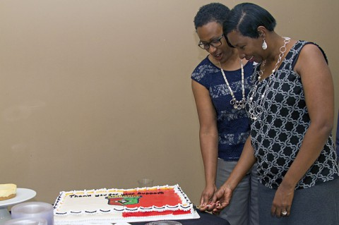 Regina Hamilton and Sandra Smith, both military spouses and volunteers for the 101st Sustainment Brigade (Lifeliners), 101st Airborne Division (Air Assault), cut a cake during a volunteer appreciation ceremony hosted by the Lifeliners brigade, May 8, 2014, at Fort Campbell, KY. (U.S. Army photo by Sgt. Sinthia Rosario, 101st Sustainment Brigade Public Affairs)