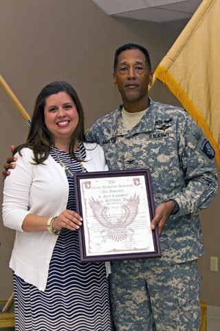 Col. Charles R. Hamilton, commander of the 101st Sustainment Brigade (Lifeliners), 101st Airborne Division (Air Assault), gives Amy Shenk the 101st Airborne Division (AA) and Fort Campbell Eagle Service Award during a volunteer appreciation ceremony, May 8, 2014, at Fort Campbell, KY. (U.S. Army photo by Sgt. Sinthia Rosario, 101st Sustainment Brigade Public Affairs)