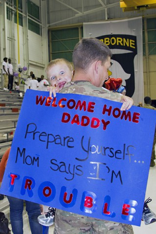 Sgt. Kyle Strey, a native of Toledo, Ohio and a maintenance and retention NCO with the 227th Quartermaster Company, 129th Combat Sustainment Support Battalion, 101st Sustainment Brigade, 101st Airborne Division (Air Assault), embraces his son Owen, 4, during a welcome home ceremony May 4, at Fort Campbell.  (U.S. Army photo by Sgt. 1st Class Mary Rose Mittlesteadt, 101st Sustainment Brigade Public Affairs)