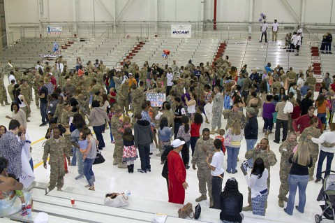 Hanger 3 at Campbell Army Airfield turned into a scene of joyful chaos moments after the Soldiers of the 227th Quartermaster Company, 129th Combat Sustainment Support Battalion, 101st Sustainment Brigade, 101st Airborne Division (Air Assault), received permission to break ranks and reunite with their Families May 4, at Fort Campbell. (U.S. Army photo by Sgt. 1st Class Mary Rose Mittlesteadt, 101st Sustainment Brigade Public Affairs)