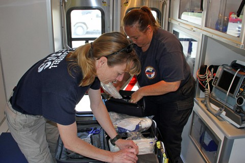 Emergency Medical Technician Karla Best and Paramedic Teresa Hegerty take inventory of their ambulance equipment  May 21, 2014 to prepare for possible medical emergencies throughout Fort Campbell, Ky. (U.S. Army photo by Sgt. Eric Lieber)