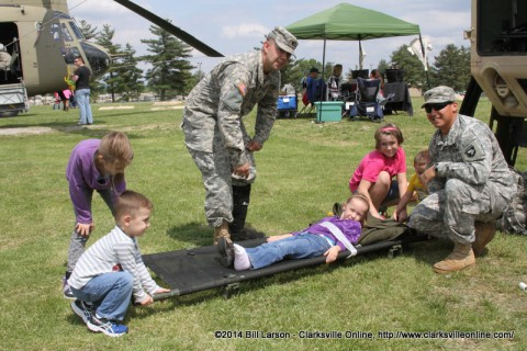 Brooklyn Blaylock is strapped to a stretcher at the 2014 Week of the Eagles Static displays