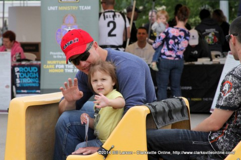 A young lady and her father enjoy the trackless train at the 2014 Week of the Eagles Spectacular Saturday Community Fair