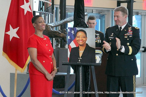 Valerie Hunter-Kelly receives the acclaim of the audience after her portrait photograph is unveiled.