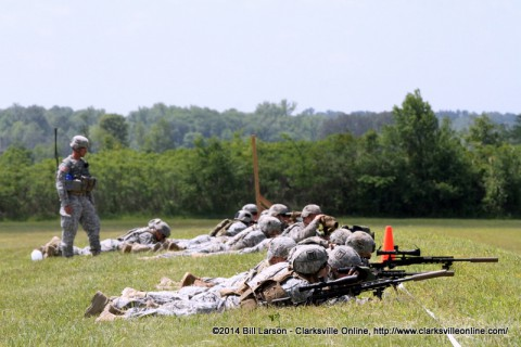 Snipers and their spotters conduct a visual search for foreign objects placed down range.