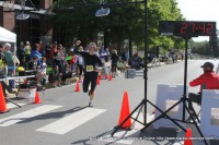 Daniel Christian wins the 7k Road Race  at the 2014 Queen City Road Race