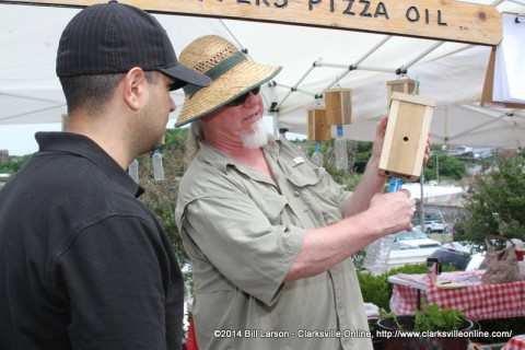 Nick Pappas shows his products to a potential customer