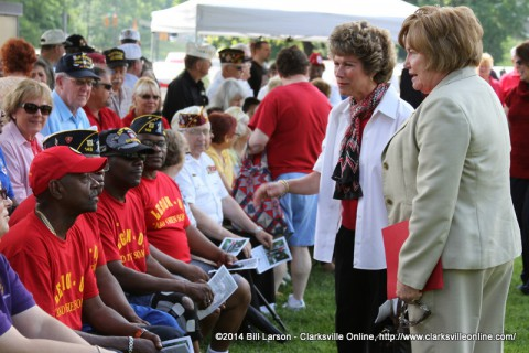 Clarksville Mayor Kim McMillan and Montgomery County Mayor Carolyn Bowers talk to veterans at the 2014 Montgomery County Memorial Day Ceremony
