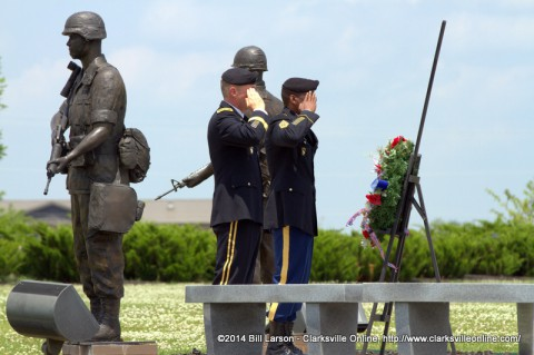 Maj. Gen. James C. McConville and Command Sgt. Maj. Alonzo J. Smith lay a wreath before the 101st Airborne Division monument at the 101st Airborne  Division Headqurters on Memorial Day