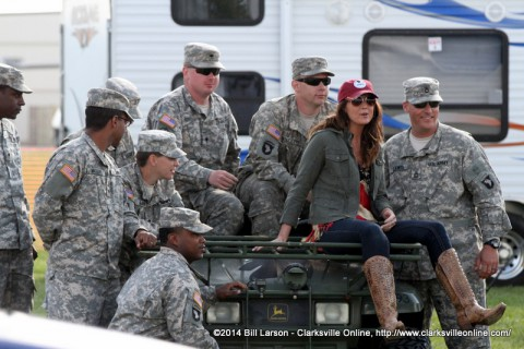 Mallory Hope takes a break with some of the Soldiers working at the concert