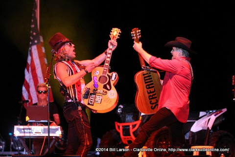 Big Kenny and John Rich performing on Stage at the 2014 Week of the Eagles Concert on Friday