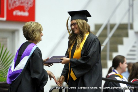 A Clarksville High School Graduate receives her diploma from Principal Jean Luna