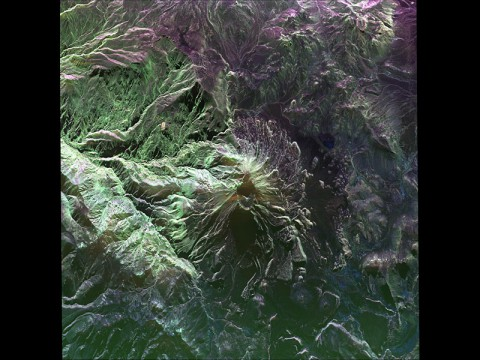 This false-color image of Peru's Ubinas volcano was acquired on April 14, 2014, by NASA's Uninhabited Aerial Vehicle Synthetic Aperture Radar, or UAVSAR. (NASA/JPL-Caltech)