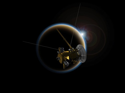 Artist's rendering of NASA's Cassini spacecraft observing a sunset through Titan's hazy atmosphere. (NASA/JPL-Caltech)