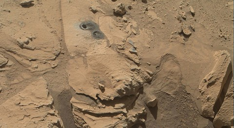 "This May 12, 2014, view from the Mars Hand Lens Imager (MAHLI) in NASA's Curiosity Mars Rover shows the rock target ""Windjana"" and its immediate surroundings after inspection of the site by the rover by drilling and other activities. (NASA/JPL-Caltech/MSSS)"