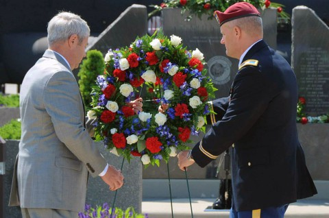 Col. John R. Evans, Jr. commander, 160th Special Operations Aviation Regiment (Airborne) and Col. (R) Vincent Reap, president, Night Stalker Association, place a wreath at the base of the Night Stalker Memorial during the annual Week of Night Stalker Activities Memorial Ceremony held at Fort Campbell, Ky., May 21, 2014. (U.S. Army photo by Maj. Allen Hill, 160th SOAR Public Affairs)