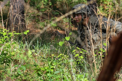 A U.S. Army Soldier with 4th Infantry Brigade Combat Team (Airborne), 25th Infantry Division moves toward a breach in a wire obstacle during a decisive action training environment exercise at the Joint Readiness Training Center in Fort Polk, LA, April 25, 2014. The decisive action training environment tests a brigade combat team's ability to conduct offensive, defensive and stability operations while supporting a foreign government. (Photo by Staff Sgt. Christopher Klutts, 20th Public Affairs Detachment)
