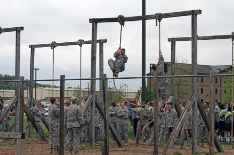 Soldiers with the 129th Combat Sustainment Support Battalion, 101st Sustainment Brigade (Lifeliner, 101st Airborne Division (Air Assault), climb ropes during Wedge Challenge, April 25, 2014 at Fort Campbell, Ky. The Wedge Challenge was an air assault competition that tested battalion leaders with a packing list layout, foot march, sling load inspection, an obstacle course and tug of war. (U.S. Army photo by Sgt. 1st Class Mary Rose Mittlesteadt, 101st Sustainment Brigade Public Affairs)