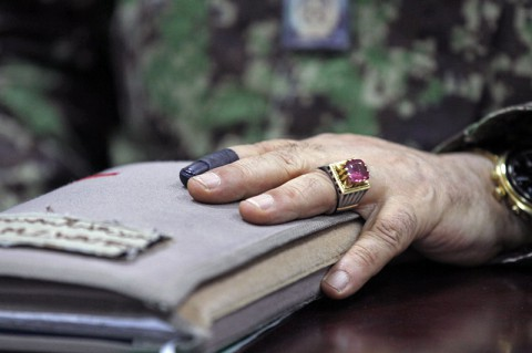 Maj. Gen. Mohammed Zaman Wazeri, the commander of the 201st Corps Afghan National Army, displays is inked index finger that symbolizes his participation in the Afghan national runoff election at Forward Operating Base Gamberi in Laghman province, June 14, 2014. (Sgt. David Cox, 2nd Brigade Combat Team Public Affairs)