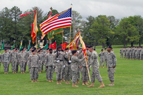 "Maj. Gen. James C. McConville (right), commanding general of the 101st Airborne Division (Air Assault), passes the unit colors to Col. Kimberly J. Daub (left), incoming commander of the 101st Sustainment Brigade ""Lifeliners,"" 101st Airborne Division (Air Assault) during a change of command ceremony June 10, 2014, at Fort Campbell, Ky. (U.S. Army photo by Sgt. 1st Class Mary Rose Mittlesteadt, 101st Sustainment Brigade Public Affairs)"